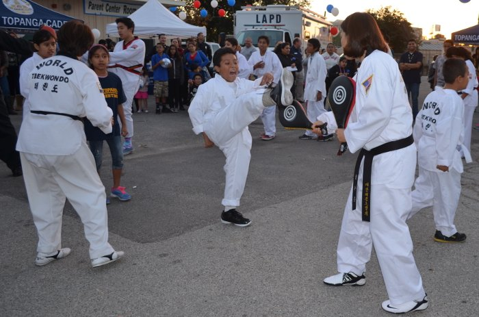 The Topanga Police Activities League taekwondo class gives a demonstration at the grand opening of the PAL Youth Center at Canoga Park High School on Wednesday.